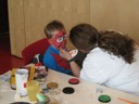 Kinderschminken durch die Mittagsbetreuung und das Rote Kreuz